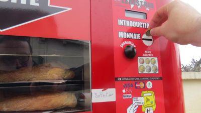 Système de paiement pour distributeur de pain