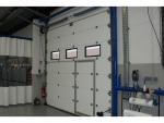 Porte industrielle porte service intégrée