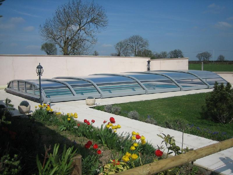 Sokool produits abris de piscines for Abri piscine telescopique