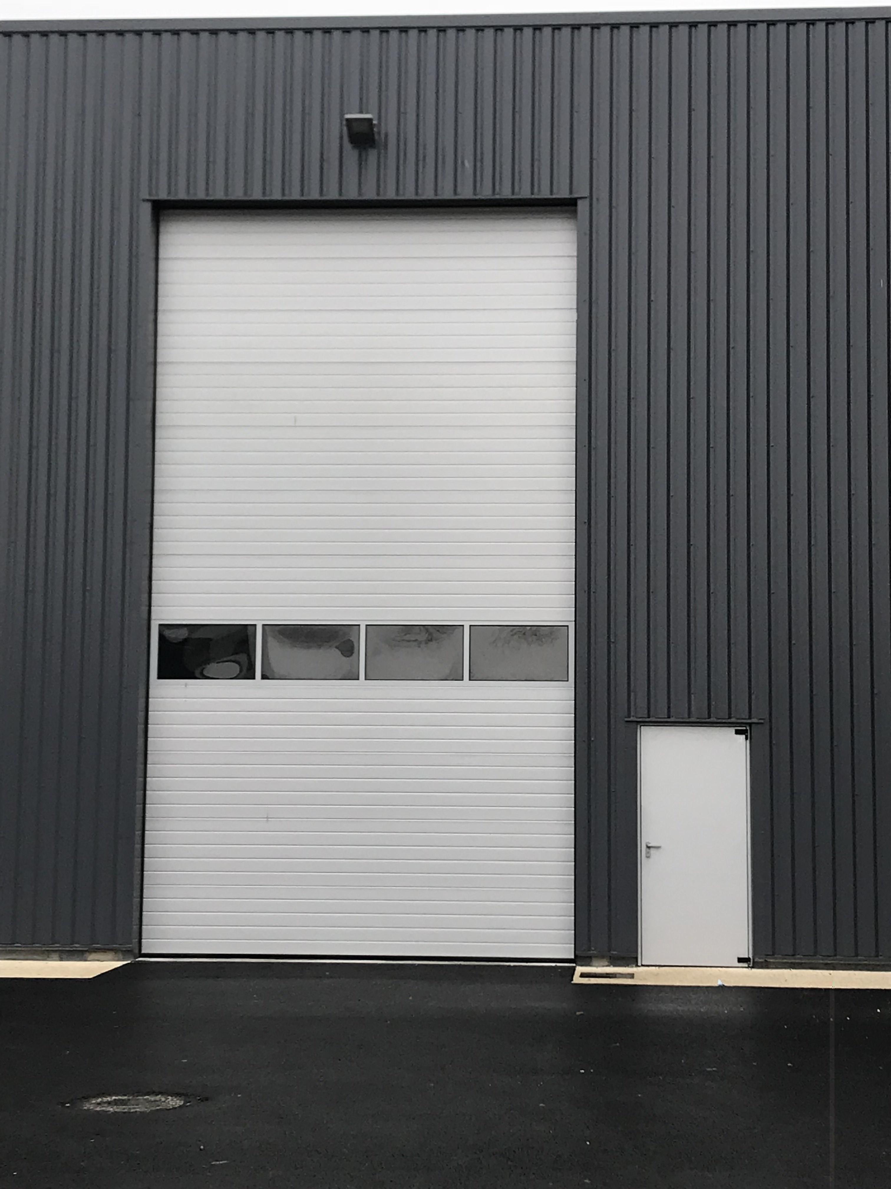 More Porte Sectionnelle Industrielle Occasion Ways Kvazarinfo - Porte placard coulissante jumelé avec serrurier depannage paris