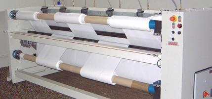 Machine de coupe textile au defile