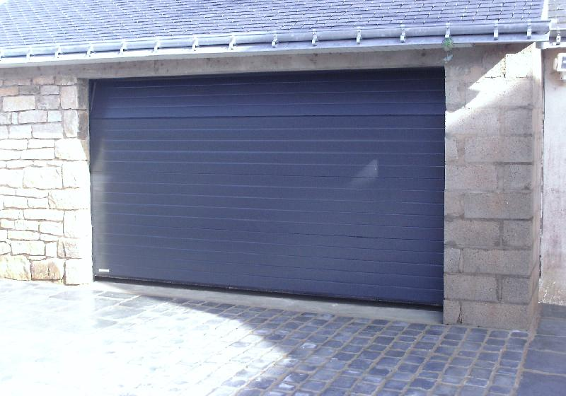 Pro fermetures auray produits portes de garage sectionnelles for Tbs pro porte de garage