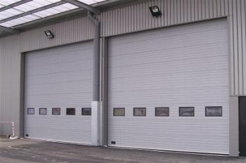 Porte sectionnelle paca fermetures industrielles for Cout porte garage