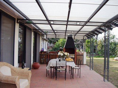 pergola a lames orientables. Black Bedroom Furniture Sets. Home Design Ideas