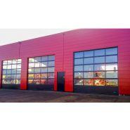 Porte sectionnelle industrielle / repliable en plafond / vitrée / en plastique / avec portillon / hermétique