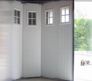 Porte de garage sectionnelle motorisee ouverture laterale en panneau sandwich avec - Porte de garage laterale motorisee avec portillon ...